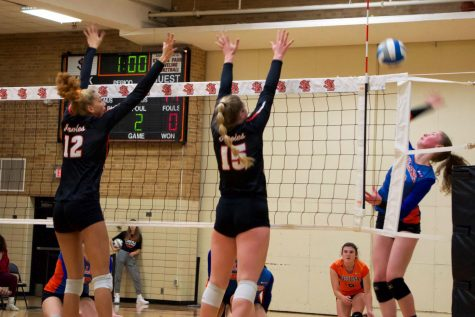 Junior Kendall Coley and senior Makaila Winward block the ball from coming to their side of the net. Girls