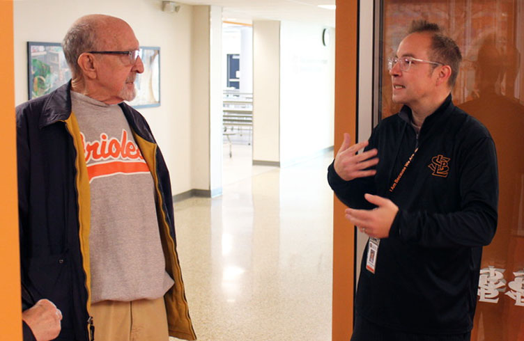 Park Spanish Immersion Principal Corey Maslowski discusses the newly renovated school with a retired Cedar Manor teacher Oct. 27. As a part of the Parade of Schools, community members were invited to tour Park Spanish Immersion, Aquila Elementary School and the Park offices.