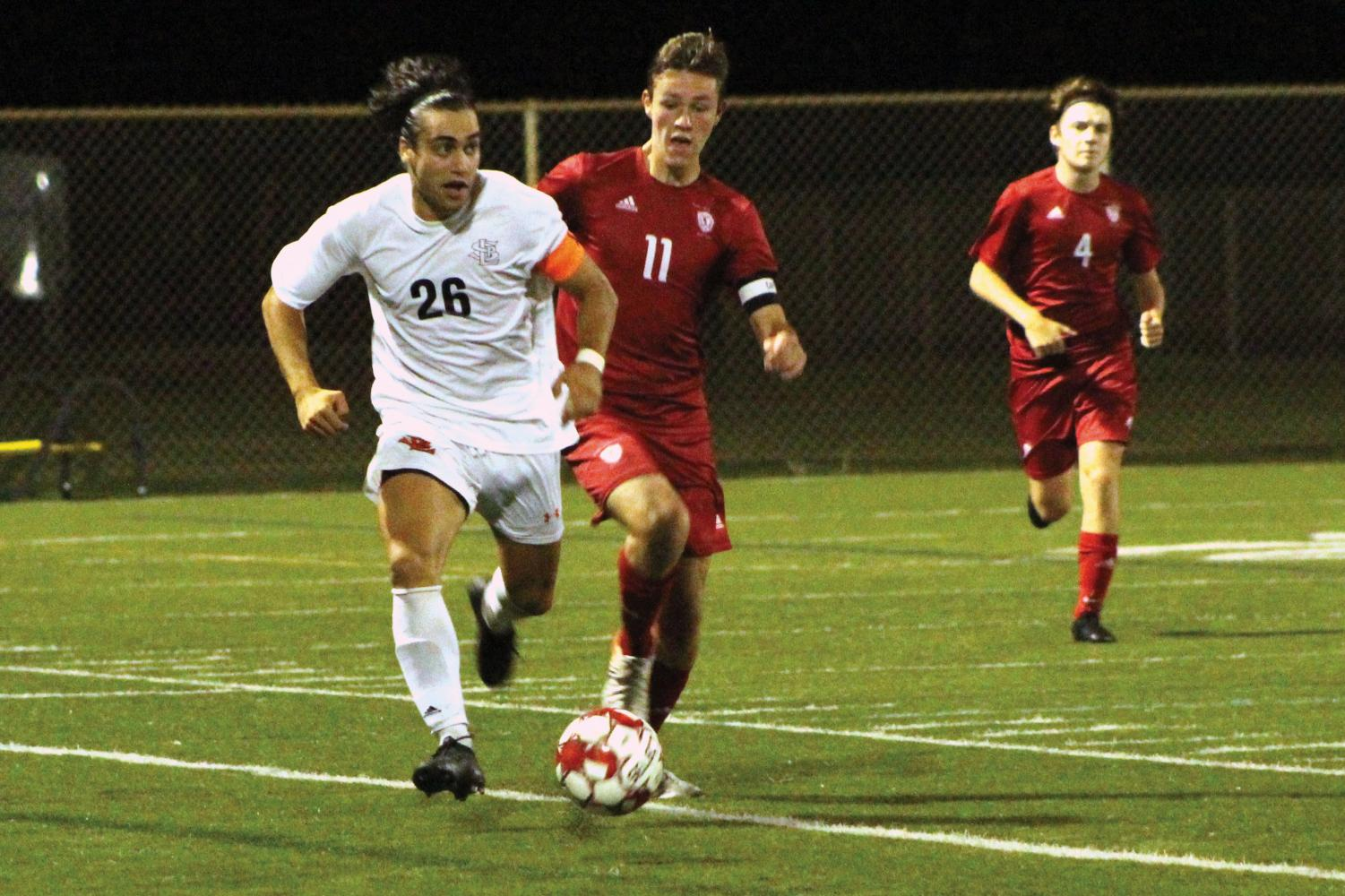 Senior Thomas Salamzadeh advances down the field, looking to pass to his teammates. Park tied 0-0 in overtime against Benilde-St. Margaret's Sept. 24