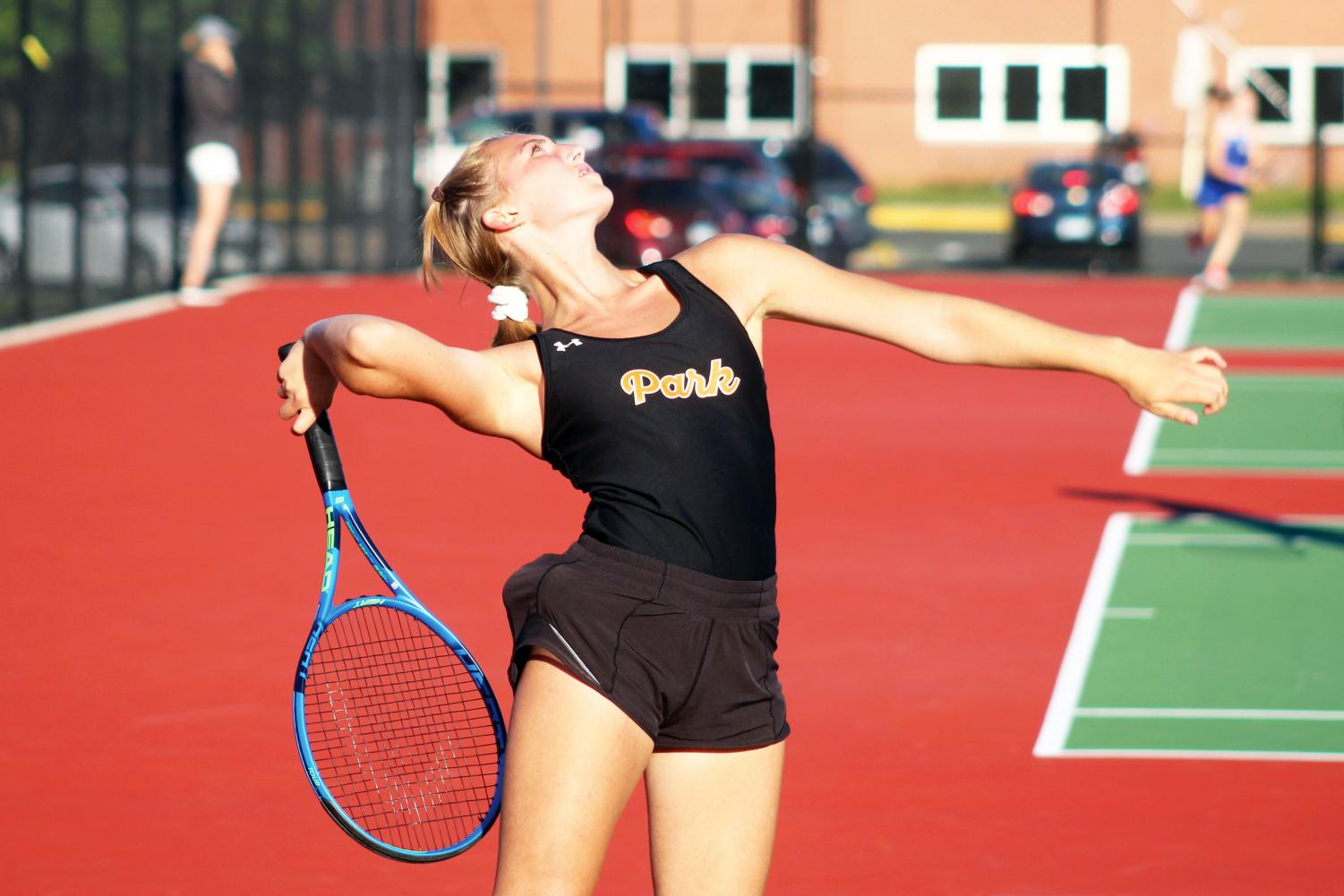 Sophomore Ava Jacobson prepares to serve the ball at her match against Holy Angels Sept. 23. Park's tennis courts were renovated over the summer of 2019.