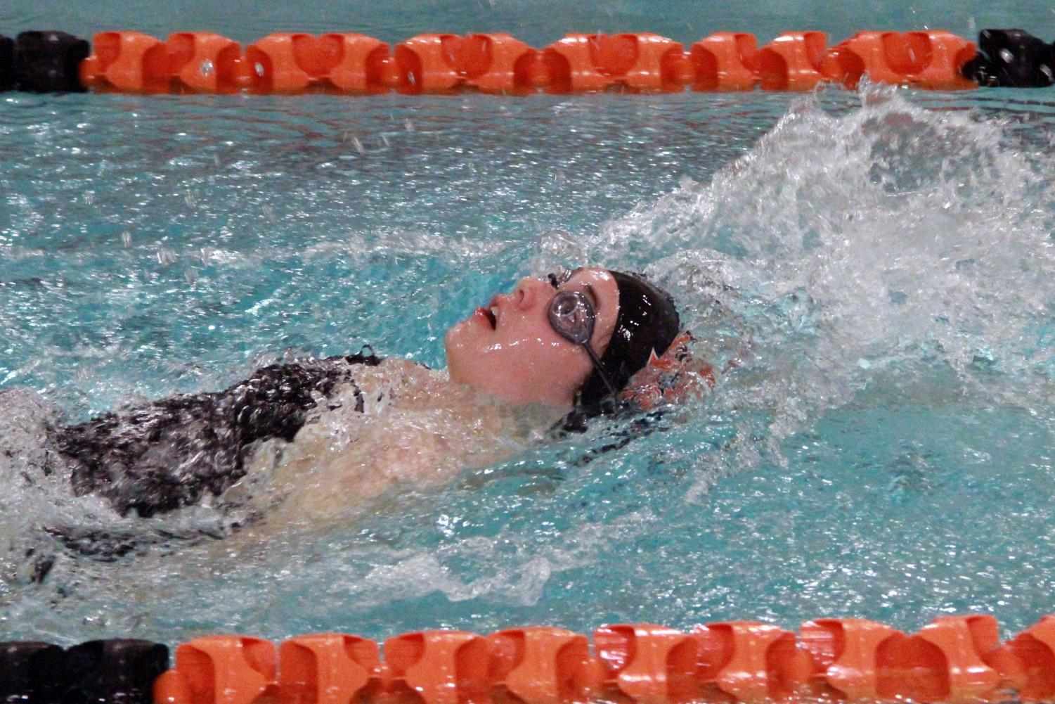 Freshman Rose Huse competes in the 100 backstroke against Hopkins Oct. 15. Park beat Hopkins 50-44.