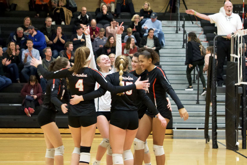 The girls' volleyball team celebrates after scoring during the sections game against Washburn Oct. 24. Park won with a final score of 3-0.