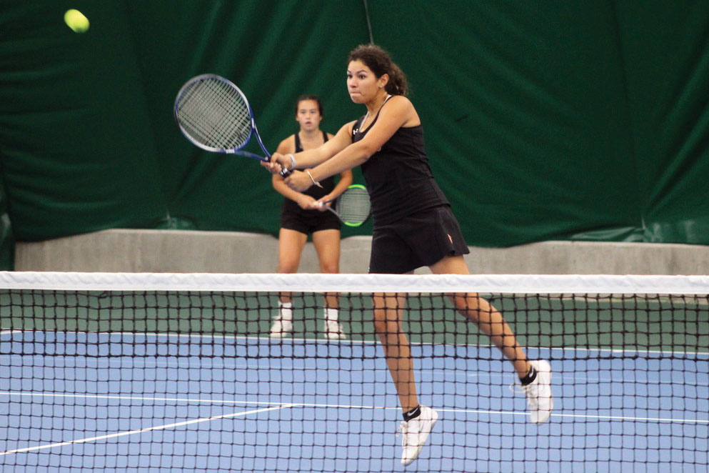 Senior Victoria Contreras hits a volley at the Sections game against Washburn. Park lost 0-7 against the Millers.