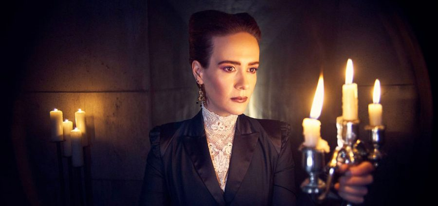 Fair use from FX Productions: Actress Sarah Paulson guides herself through darkness with a candelabra. Paulson posed for a promotional photo for