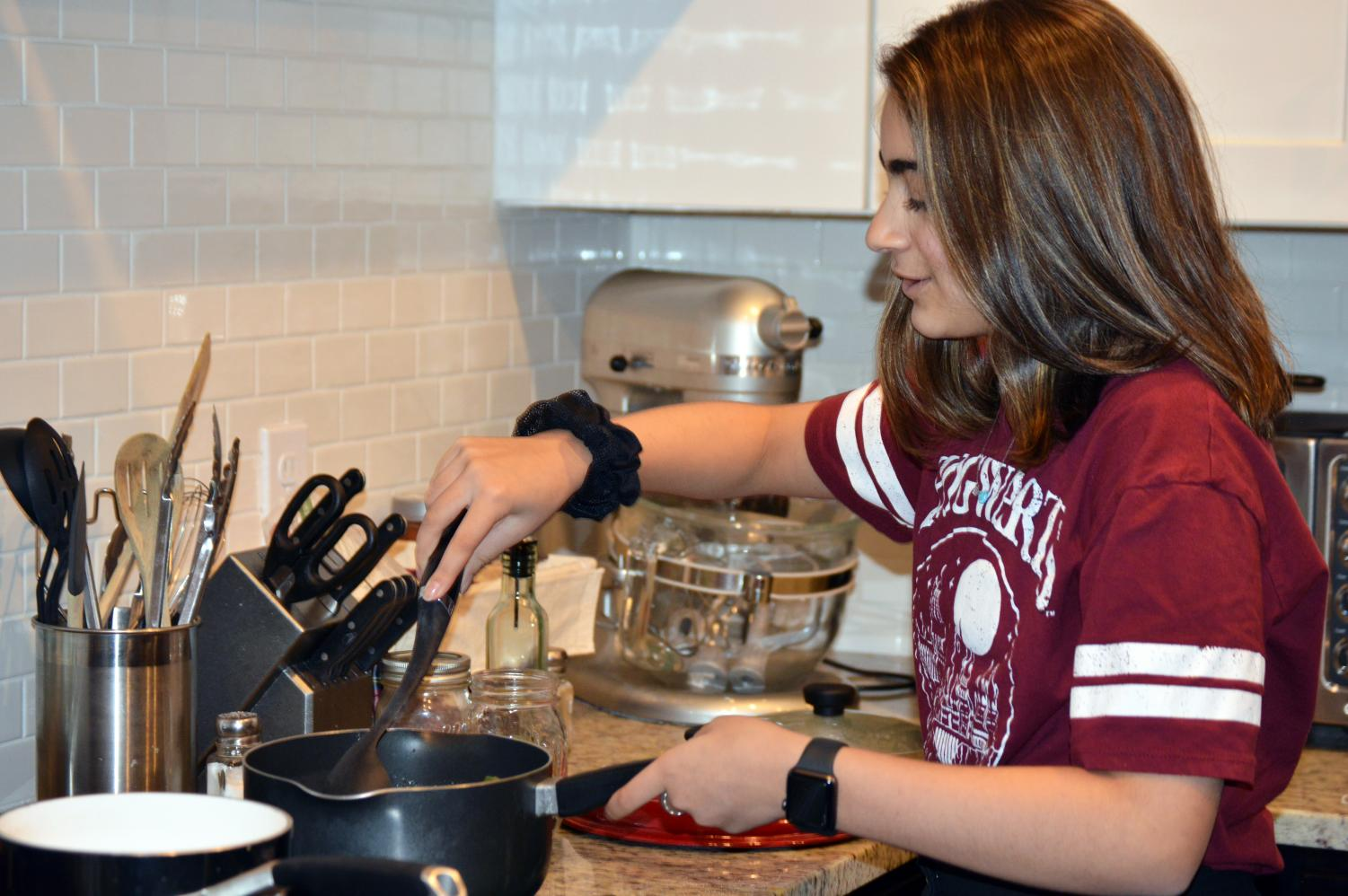 7th grader Kiran Alwy cooks curry for dinner Nov. 18. She will be showcasing her cooking skills her dad taught her on Chopped Jr., which started airing Nov. 19