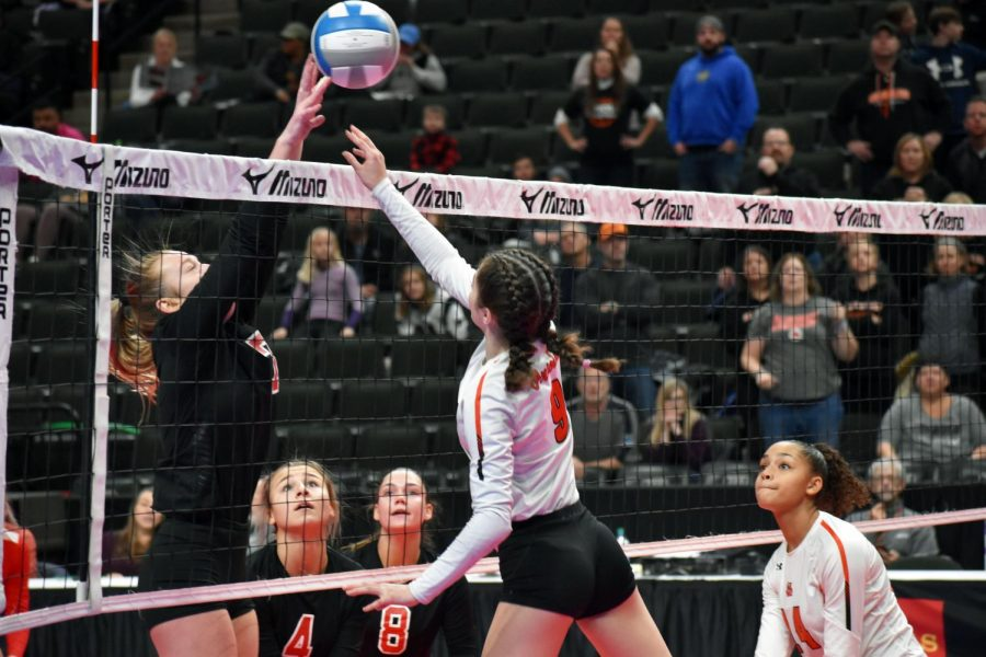 """Sophomore Elsa Bergland tips the ball over the net. Coach Whitney Meierotto-Simon said, """"Being here at State is only going to help us prepare for next year. It doesn't get bigger than this."""""""