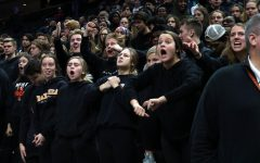 Seniors Ava Bishop, Sarah McCallon, Emma Roloff and Sydney Ring yell after the referee makes a call against Park. The dress code Nov. 7 was blackout.