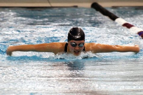 Junior Esther Putzier swims the 100 yard butterfly for Park