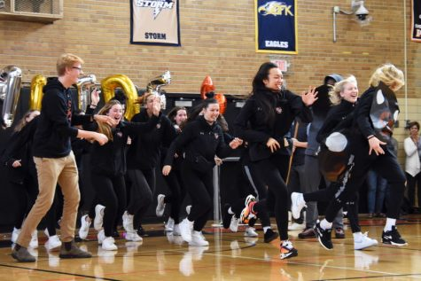 "Park's volleyball team runs through a ""Go Park VBall"" banner. The pep fest Nov. 6 was held in celebration of Park volleyball's first State qualification."