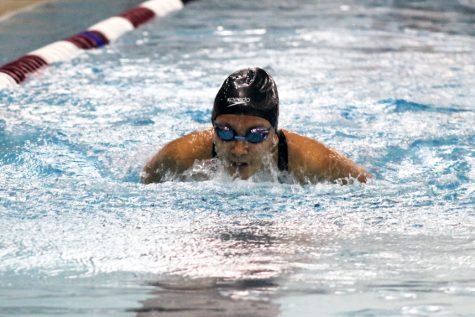Sophomore Tenzin Dedhen swims the 100 yard butterfly at the second Section swim meet Nov. 8. The State finals will be at 12 p.m. Nov. 15-16 at Jean K. Freeman Aquatic Center at the University of Minnesota