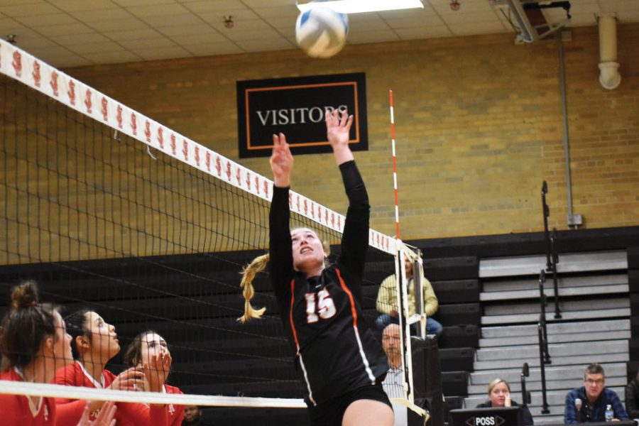 Senior and captain Makaila Winward sets the ball to a hitter during the match Oct. 29 against Benilde-St. Margaret's at St. Louis Park High School. Park won the match in the first three sets, sending them onto the section championships.