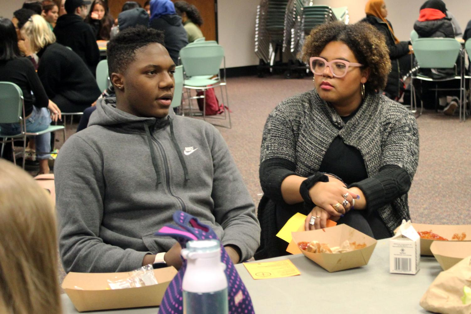 Sophmore Kendrick Ross Jr.  reflects on his experiences with race and identity while his peers listen intently at the Students Organized for Anti-Racism event Nov. 25. Senior Amaya Foku leads the conversation throughout the meeting.