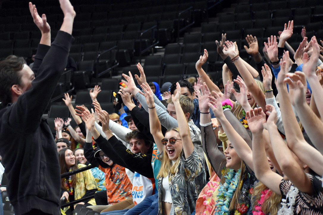 Math teacher Robert Otto leads the cheer at the State volleyball tournament against Moorhead Nov. 8. According to the School Board students and administration should give more attention and enthusiasm to other clubs and activities.