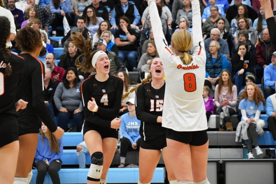 The+girls+volleyball+team+celebrates+after+scoring+a+point+in+the+varsity+Sections+match+against+Bloomington+Jefferson+Nov.+2.+Park+won+the+match+3-2.