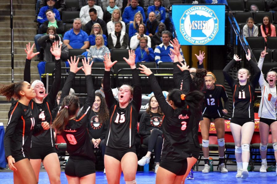 The volleyball team celebrates after a score during the Nov. 7 match. The teams next match is 9 a.m. Nov. 8 at Xcel Energy Center.