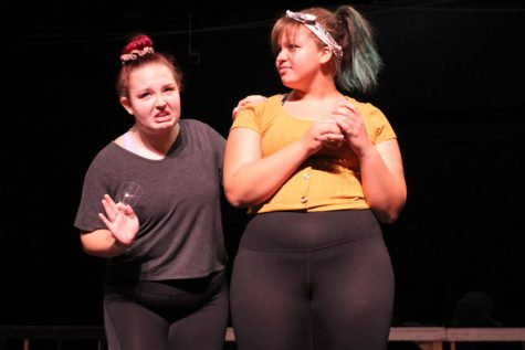 Sophomores Olivia Brown and Mackenzie Peshong rehearse the opening number of the upcoming fall musical
