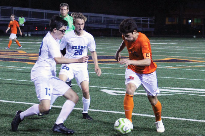 """Senior Nick Riley steals the ball from a Blake player at the """"Oriole"""" Stadium Sept. 17. This will be the second turf fi eld available for Park athletes to use once the track infi eld turf construction is complete."""