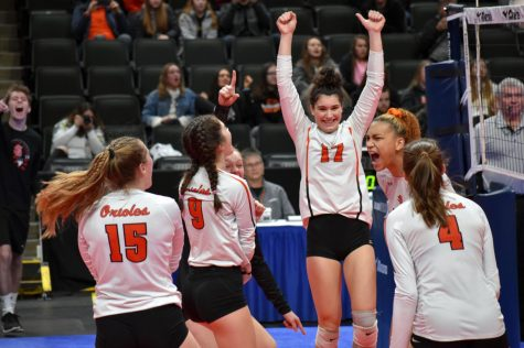 Juniors Hannah Howell and Kendall Coley rejoice after scoring a point against Moorhead. According to assistant principal Jessica Busse, nine buses transported students to the Xcel Energy Center Nov. 8.