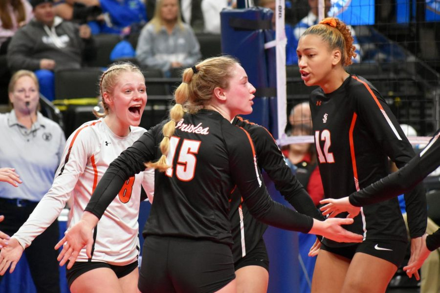 Seniors Addie Ward, Makaila Winward and junior Kendall Coley celebrate after winning a point. Parks record this season is 21-6.
