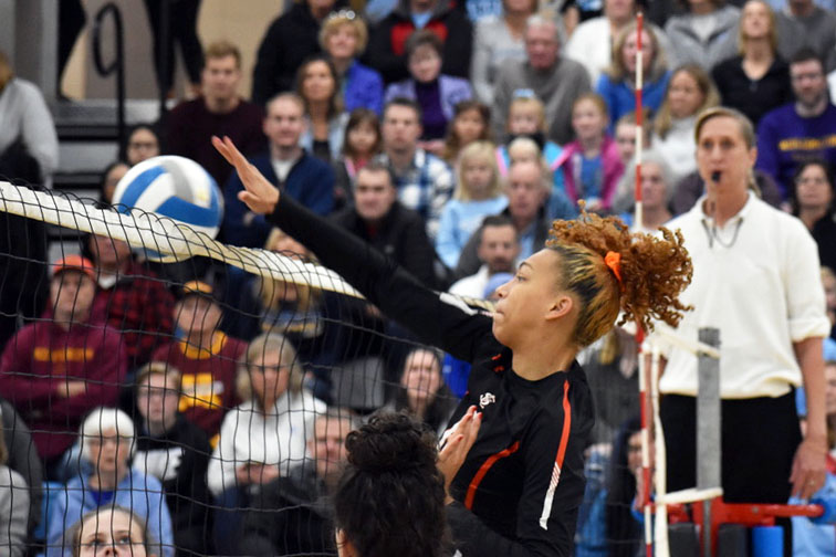 Junior Kendall Coley hits the ball over the net during the Sections Finals Nov. 2. The State matches will be played as a double elimination Nov. 7 and Nov. 8.