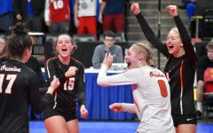 Seniors Makaila Winward, Addie Warg and junior Maya Betzer celebrate after scoring a point against Eagan. The State tournament is taking place at the Xcel Energy Center Nov. 7-9.