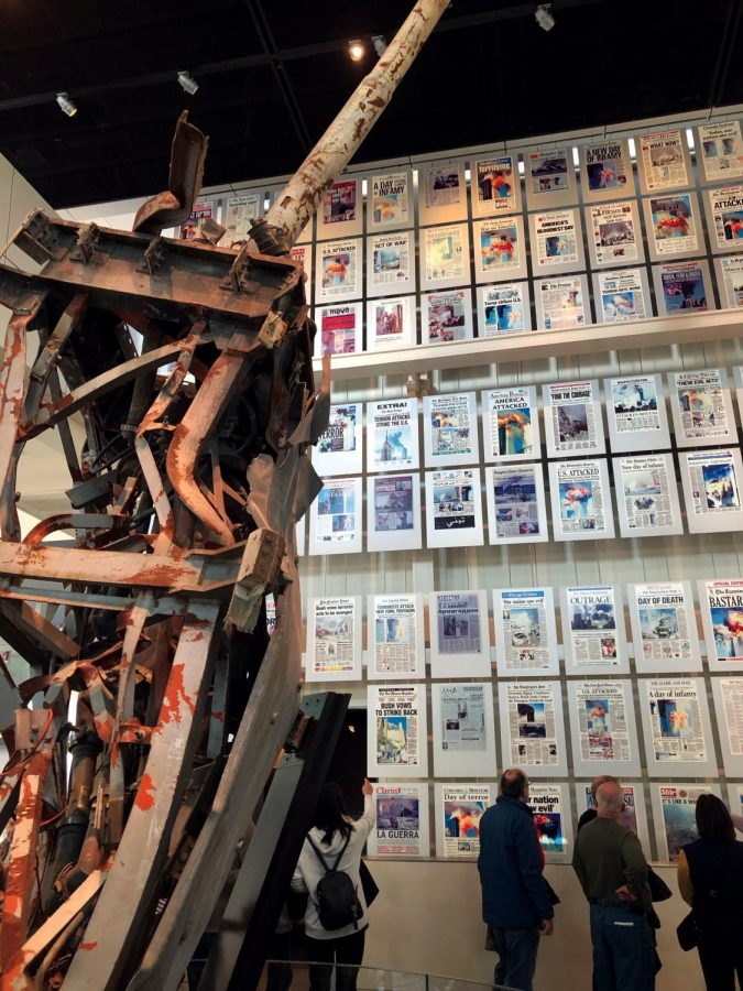 Visitors view the 9/11 exhibit at the Newseum in Washington D.C. On display are various front pages from 9/12 and the antenna from the top of the World Trade Center. Free press was key in reporting on the tragedy of 9/11.