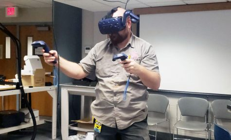 The school technician Trevor Paulson tests out the new virtual system. The virtual system is meant to help him make logos for companies.