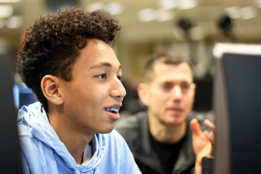 Freshman Amanuel Shetaye works with mentor Dan Klobucar during the ACE meeting Dec. 19. According to Klobucar, ACE recently has experienced growth in number of participants.