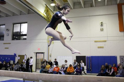 Junior Raina Kronfeld performs her beam routine Dec. 21 at North Star Elementary. Park placed first in the invitational meet that consisted of five other teams.
