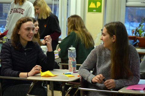 Junior Elizabeth Orton and junior Kathryn Schug collaborate while making cards. Feminism Club and Letters of Love combine meetings to gain engagement.