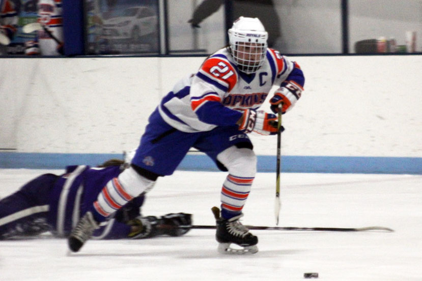 Senior Sarah McCallon takes the puck up the rink Dec. 17. Hopkins/Park won against Red Wing 8-3.