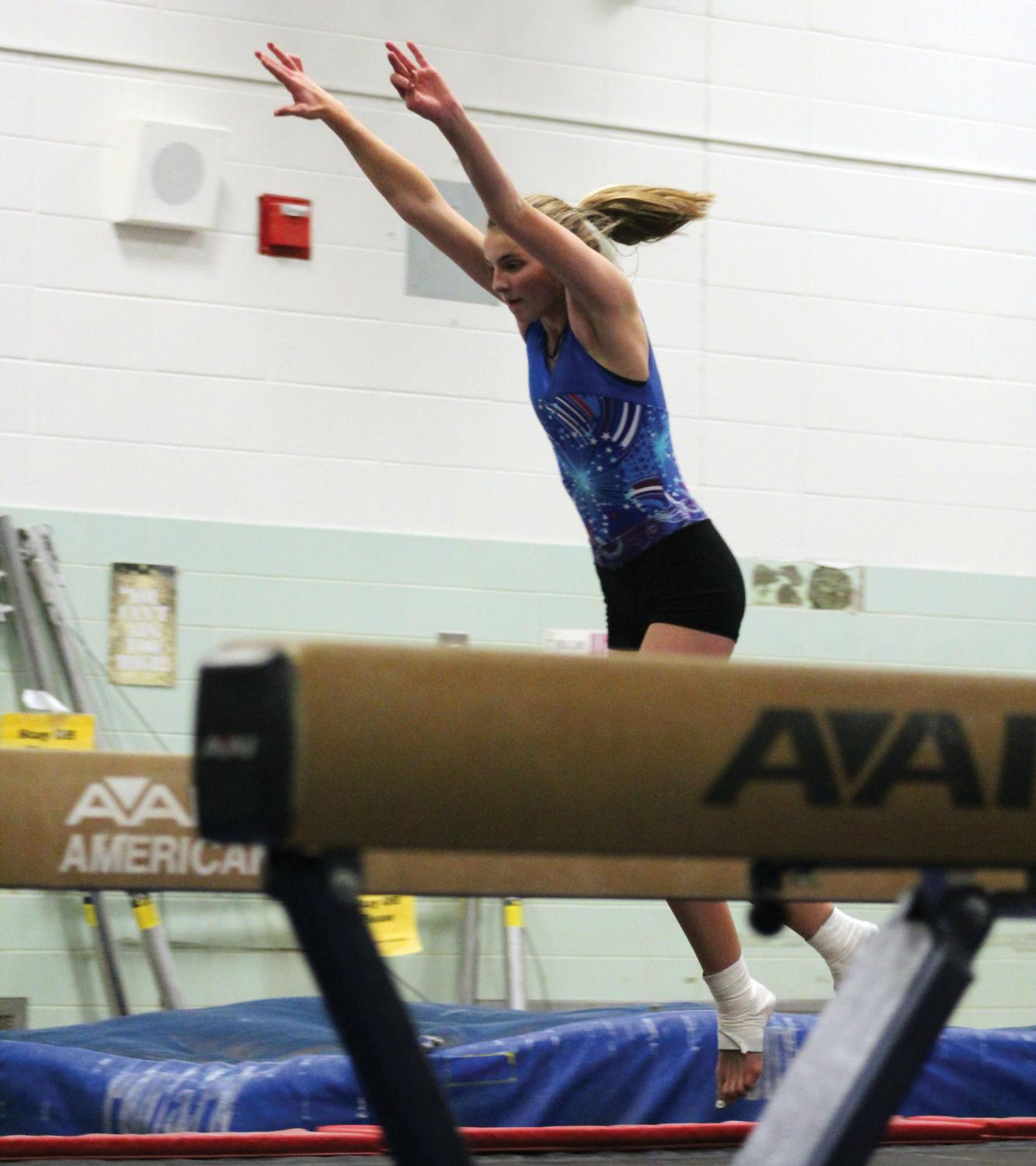 Sophomore Ryan Rasmussen prepares to complete a tumbling pass at gymnastics practice Nov. 25. The gymnastics team's first meet is at 11 a.m. Dec. 7 at White Bear Lake Area High School.