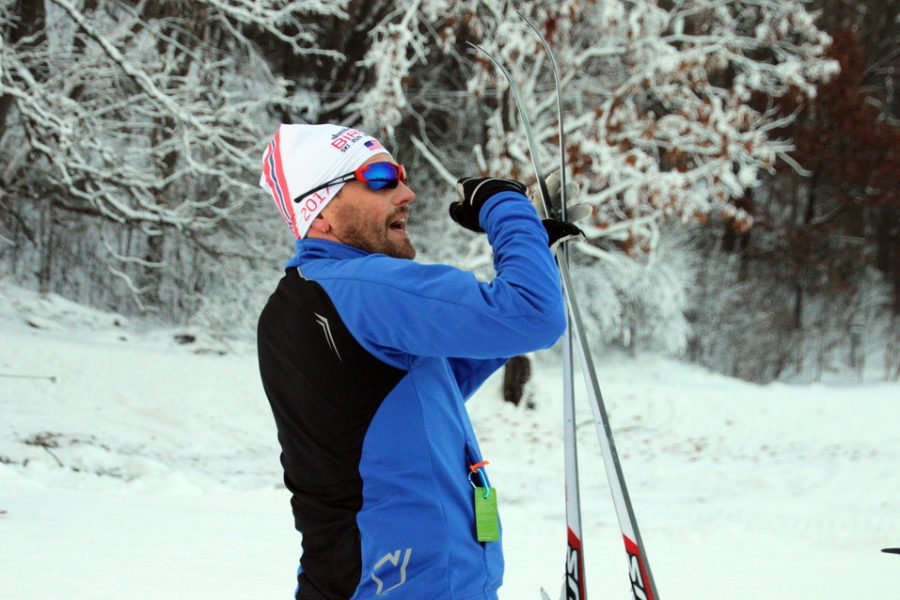 Nordic skiing coach Patrick Hartman helps instruct athletes on how to wax their skis while practicing Dec. 16 at the Theodore Wirth Park Ski Trails. Waxing skis helps to keep skis in prime condition as well as improve smooth skiing on the course.