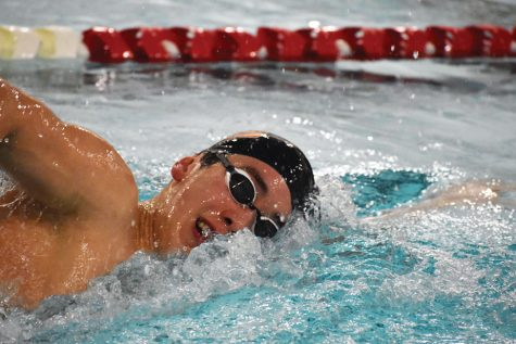 Junior Hayden Zheng wins the 500-yard freestyle against Benilde-St. Margaret's Dec. 19. Zheng will compete for the high school team for the rest of the winter season after attending the Junior Nationals meet outside Seattle, Washington.