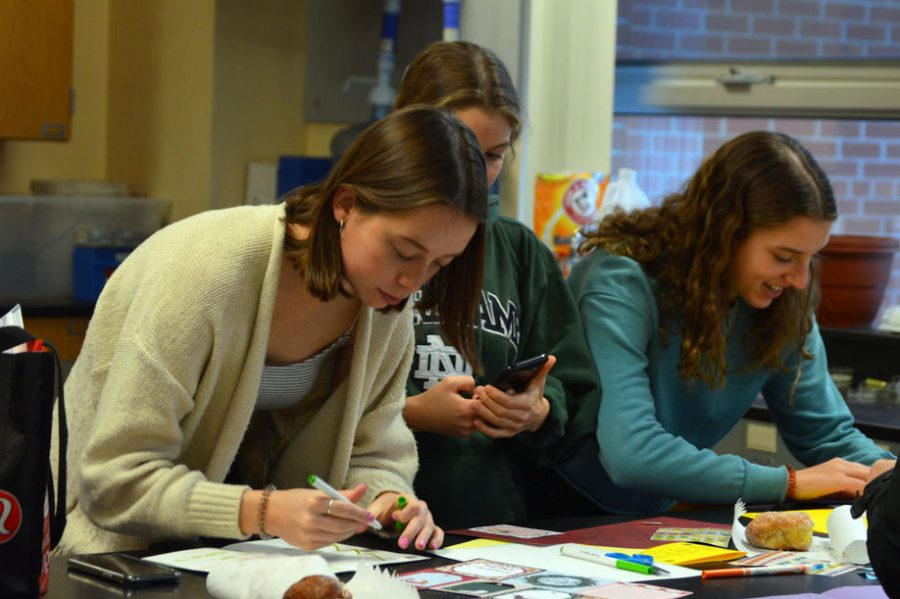 Seniors Ava Bishop, Lola Ruff and Hannah Odland create cards for sick children during the first meeting of the new club Letters of Love 12/19/19. The club took inspiration from similar clubs from Orono High School.