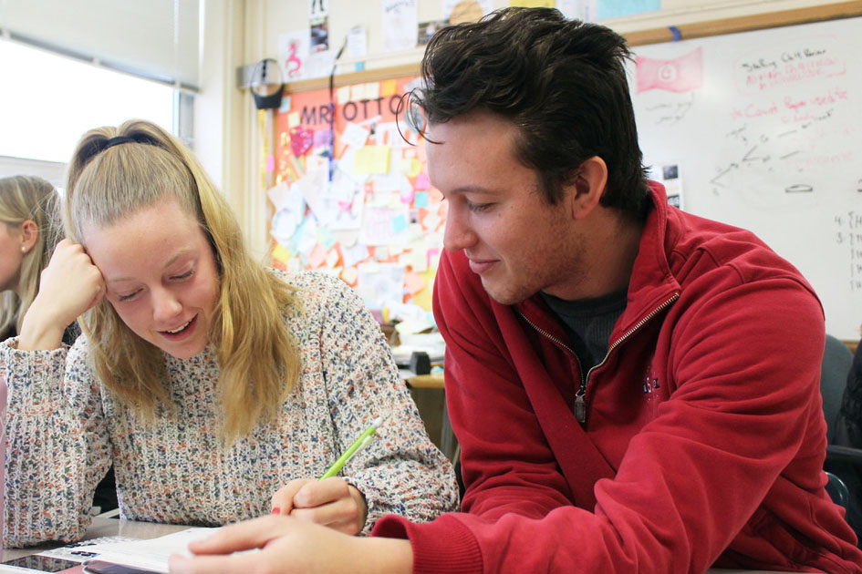 Senior Sam McGurgan works with math teacher Bobby Otto to complete a math assignment Dec. 13. Math tutoring encourages students to feel more confident in their work.