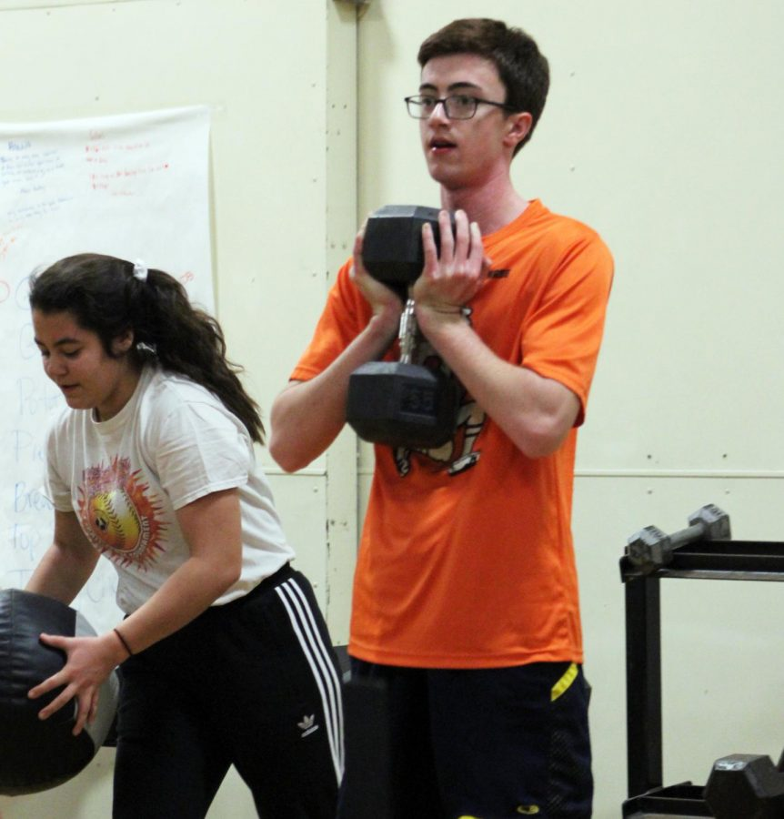Junior Josh Krueger and senior Maggie Klein lift weights at strength training Dec. 4. Nordic has morning lifting with strength coach Jessica Gust Monday and Wednesday mornings from 7–7:30 a.m.