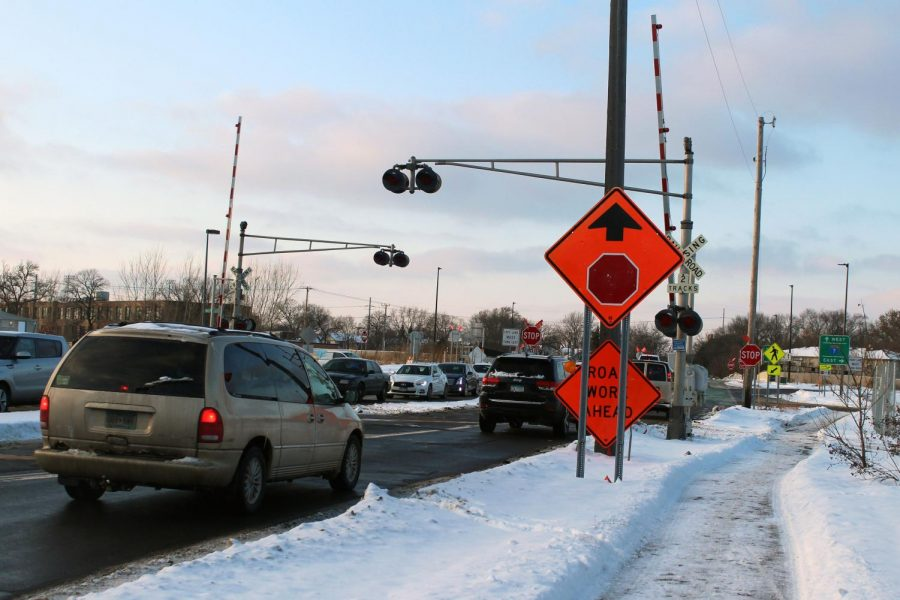 Cars drive over the railroad crossing at Wooddale Ave. S and W 36th St. The arms at this crossing have been going down without warning when there are no trains coming.