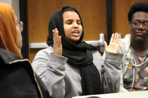 Junior Amal Abdi talks with fellow SOAR members Dec. 2, 2019. SOAR recently held a meeting with Mayor Jake Spano discussing racism in the community.