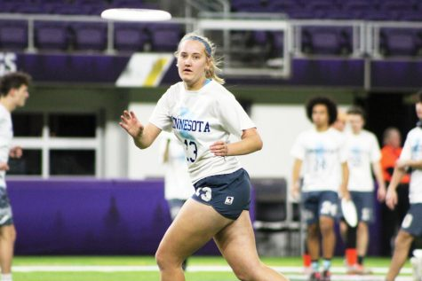 Senior Amelia Ryan reaches to catch the disc during the game against Edina Nov. 30. Marta Hill, Amelia Ryan, Lauren Schmelzler and Danny Shope played on the Minnesota All-Star team at U.S. Bank Stadium.