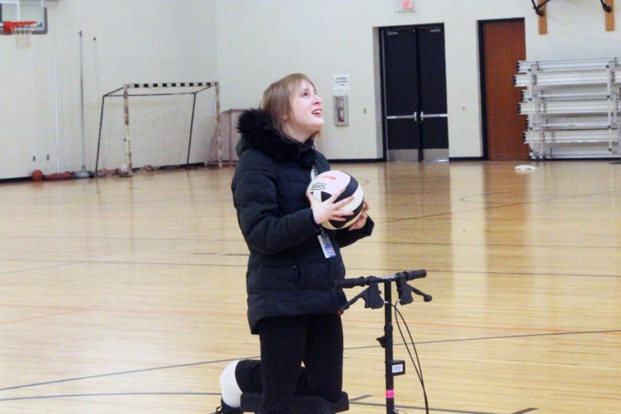 Special Education student attends gym class as part of the Special Ed curriculum. Special Ed students go to various classes throughout the day.