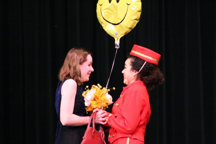 Sophomore Fiona Petrie, who plays Louise in the second scene, rushes up to sophomore Dayanara Mora-Zengel, who plays plays a telegram singer. Each scene had couples at their best and worst moments.