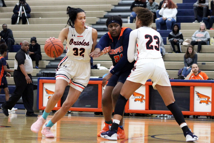 Juniors Kendall Coley and Raegan Alexander to block Robbinsdale Cooper defender junior Meme Wheeler Jan 3. Park lost to Robbinsdale Cooper 62-69. At one point during the second half, the team was down by two points.