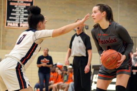 Junior Faith Johnson looks to pass the ball to one of her teammates. Park won against Robbinsdale Cooper 77-73 Jan. 30.