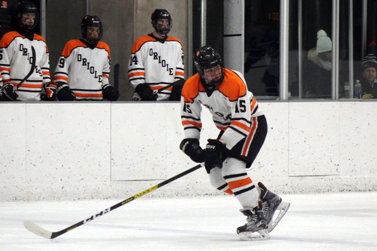 Junior McCabe Dvorak skates toward the puck during the Eastview game Jan 2. Dvorak is currently running the Boys' Hockey team instagram which has recently gained popularity.