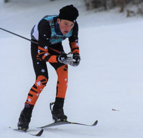 Sophomore Tait Myers races downhill in a classic ski race Jan. 4 at the Loppet High School Invite at Theodore Wirth Park. Myers and his relay partner senior Rakesh Plantz placed ninth in the boys' classic relay competition and the boys' team placed eighth overall.