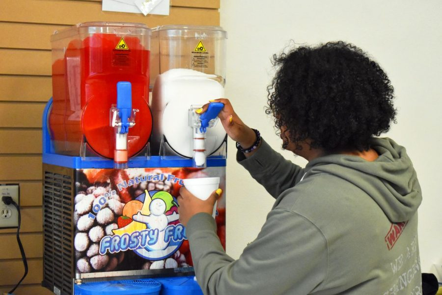 Senior Selena Nejib makes a slushee for a customer. The new slushee flavors are lemonade and strawberry lemonade.