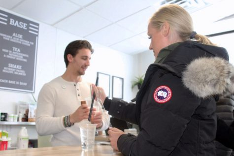 Costumer at SLP Nutrition chooses to use a straw for her drink. SLP Nutrition offers self-service straw dispensers as a way to comply with the city's Zero-Waste Packaging Ordinance.