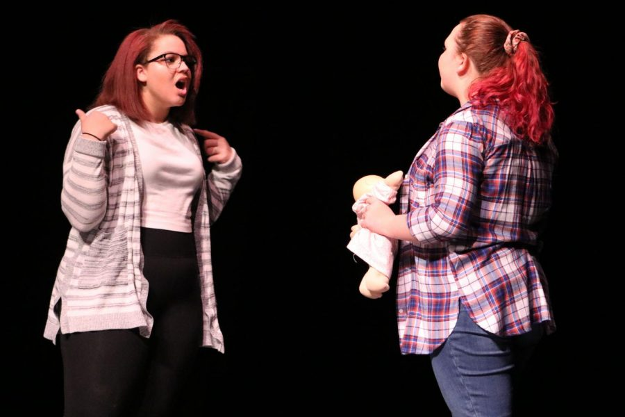 Sophomores Kenzie Peschong and Olivia Brown argue in the scene