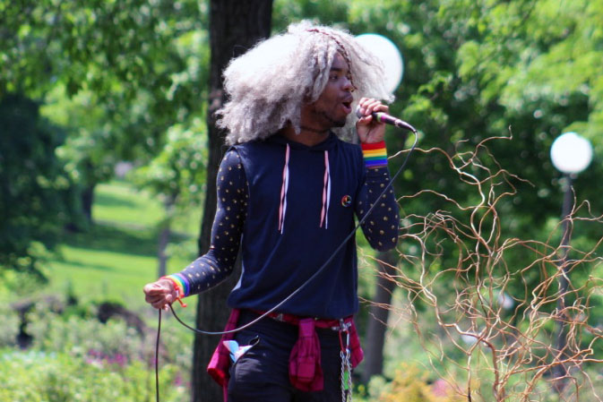 A Twin Cities resident performs at the LGBTQ teen pride event June 1. Many student from the LGBTQ club have participated in activities such as these. The club encourages a safe environment for everyone to come and have a discussion as well as support.